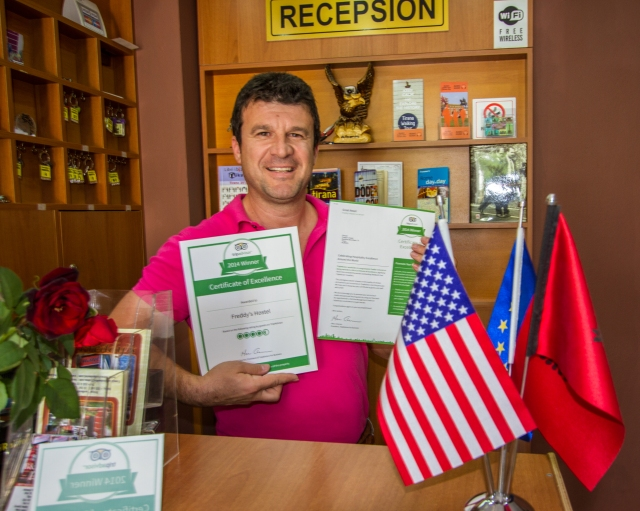 The owner, Freddy displaying his recent letters from Trip Advisor.
