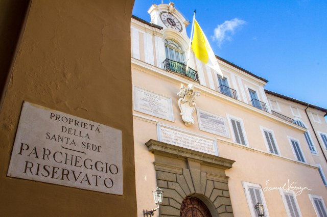 The Vatican flag flying over the Papal Palace entrance.
