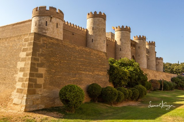 Slanting walls and formidable towers overlooking the moat.